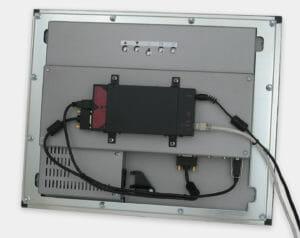 KVM-Extender montiert auf der Rückseite einer VESA-Halterung am Einbaumonitor